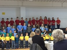 Kids singing for grandparents